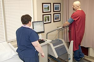 A nuclear stress test may be performed in combination with an exercise stress test, in which you walk on a treadmill. If you aren't able to exercise, you'll receive a drug through an IV that mimics exercise by increasing blood flow to your heart. A nuclear stress test can take two or more hours, depending on the radioactive material and imaging tests used. Before a nuclear stress test First, your doctor will ask you some questions about your medical history and how often and strenuously you exercise. This helps determine the amount of exercise that's appropriate for you during the test. Your doctor will also listen to your heart and lungs for any abnormalities that might affect your test results. During a nuclear stress test Illustration showing a man performing an exercise stress test Exercise stress test Before you start the test, a technician inserts an intravenous (IV) line into your arm and injects a radioactive dye (radiopharmaceutical or radiotracer). The radiotracer may feel cold when it's first injected into your arm. It takes about 20 to 40 minutes for your heart cells to absorb the radiotracer. Then, you'll lie still on a table and have your first set of images taken while your heart is at rest. A nurse or technician will place sticky patches (electrodes) on your chest, legs and arms. Some areas may need to be shaved to help them stick. The electrodes have wires connected to an electrocardiogram machine, which records the electrical signals that trigger your heartbeats. A cuff on your arm checks your blood pressure during the test. You may be asked to breathe into a tube during the test to show how well you're able to breathe during exercise. If you can't exercise, your doctor will inject the drug into your IV line that mimics exercise by increasing blood flow to your heart. Possible side effects may be similar to those caused by exercise, such as flushing or shortness of breath. You might get a headache. For an exercise stress test, you'll probably walk 